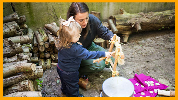 At Happy Tree Northwood nursery children are always protected. Here you can see a Key Person (a familiar carer) playing with the children in the outdoor area